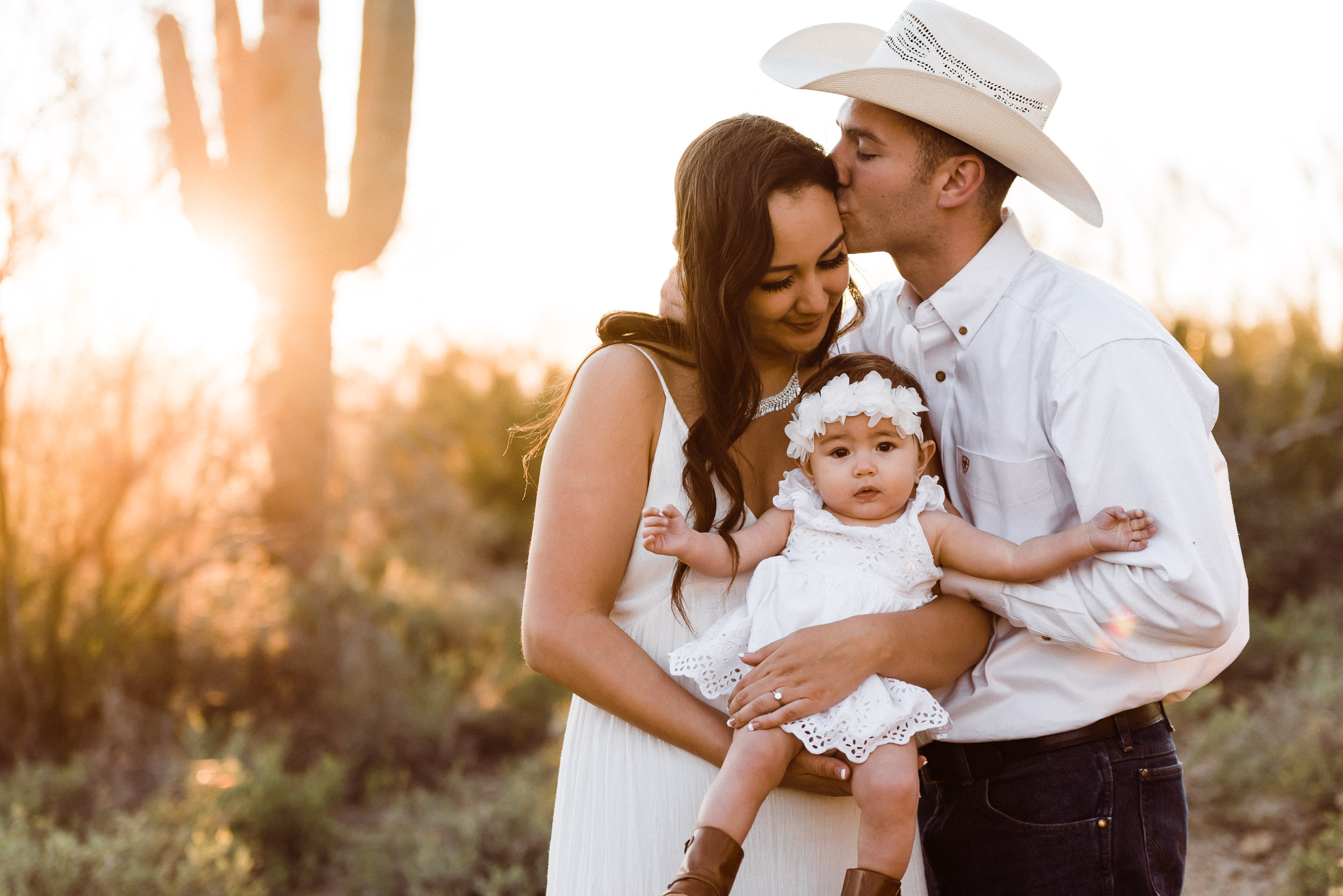 Eloping couple with a baby during and Arizona elopement in the desert.