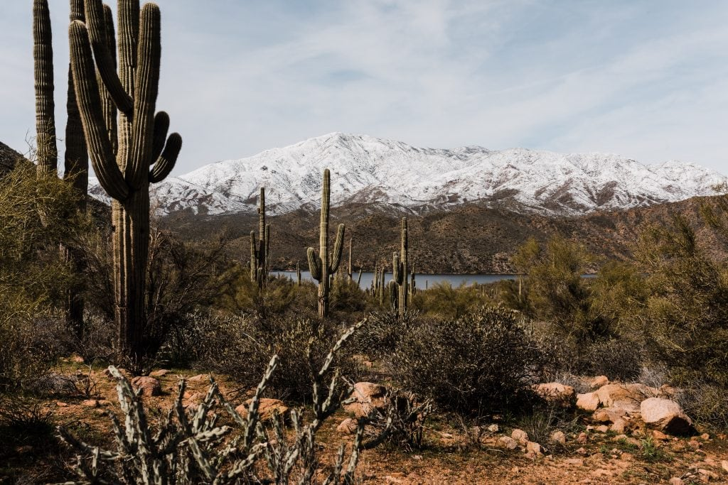 The scenic Apache Trail in the winter with snow capped mountains.
