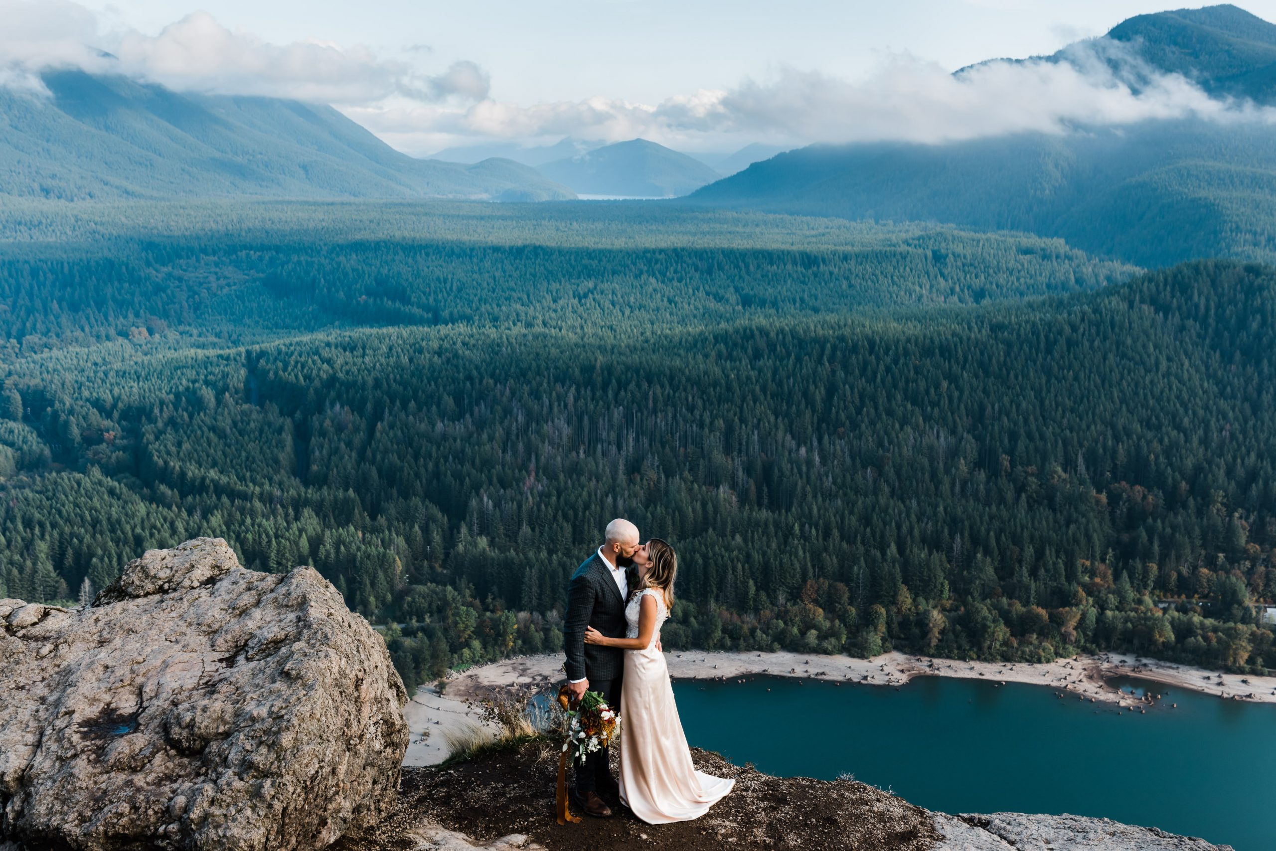 Couple eloping on top of Rattlesnake Ledge in North Bend, Washington State.