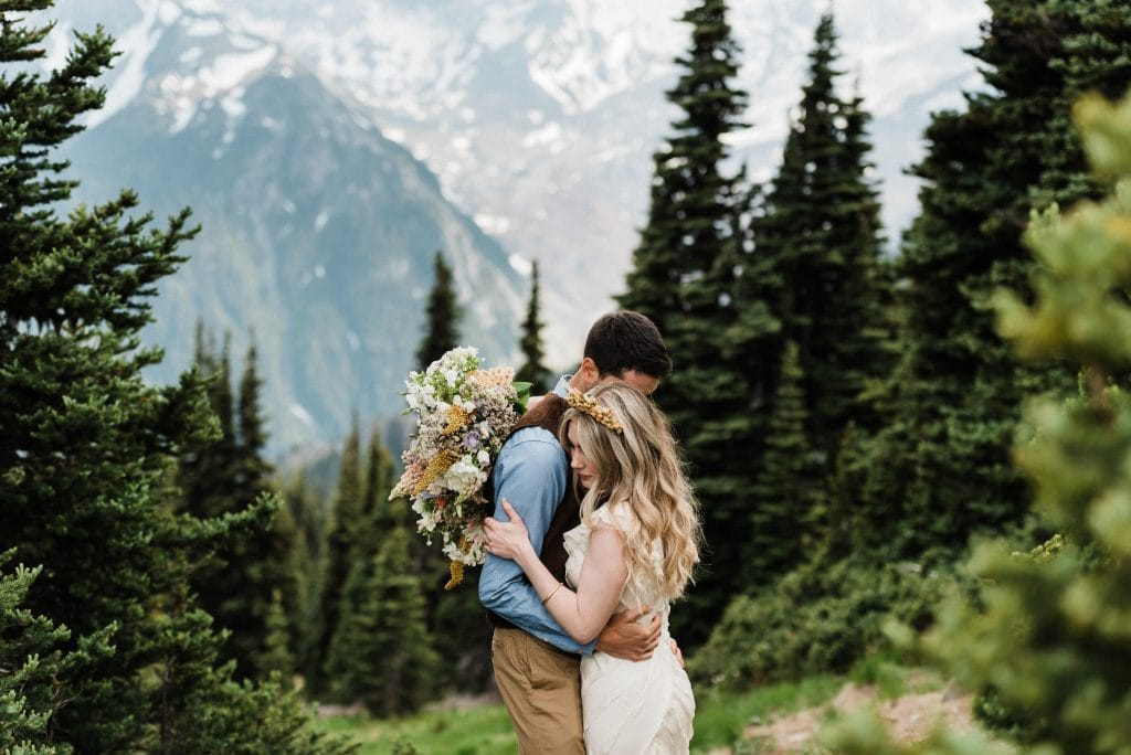 A couple hugs during a Mount Rainier elopement ceremony.