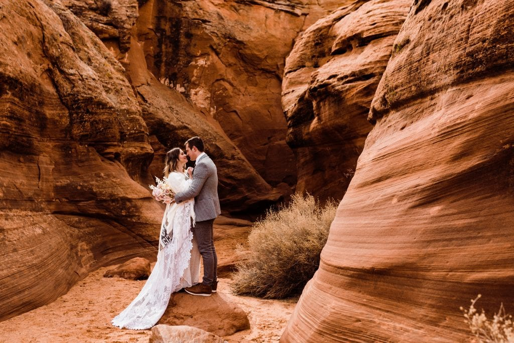 Bride and groom embracing during their elopement in a slot canyon near Page, Arizona.