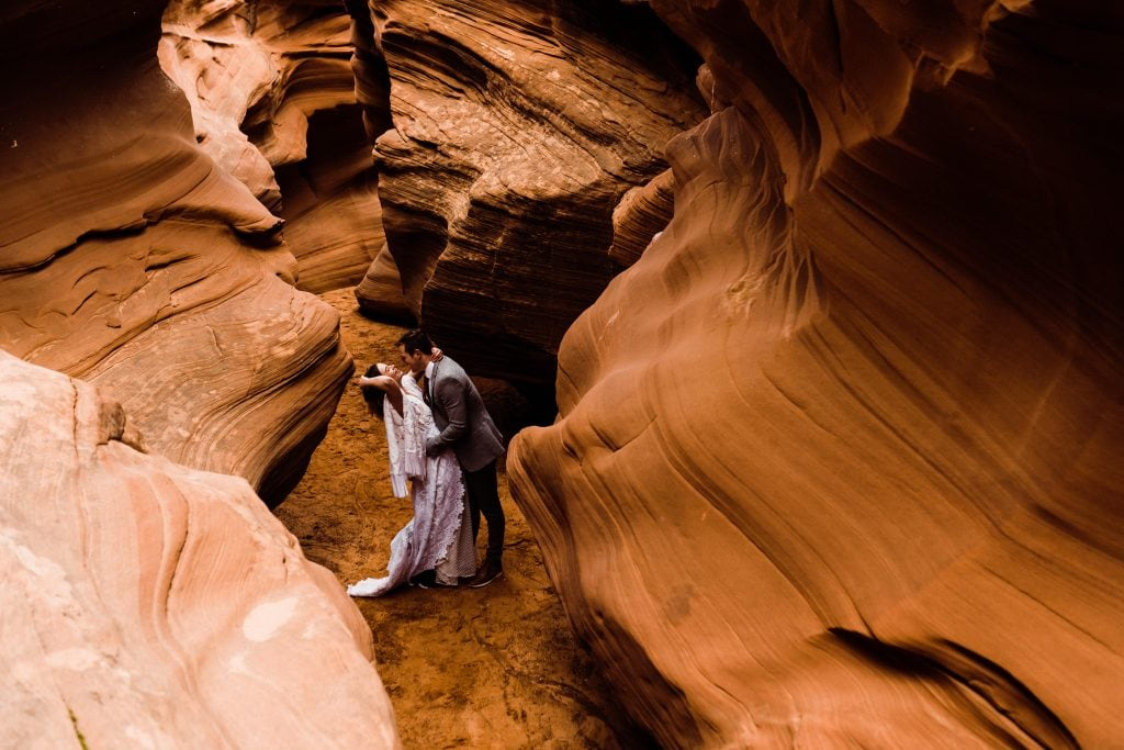 Elopement inside a secret slot canyon near Page, Arizona.