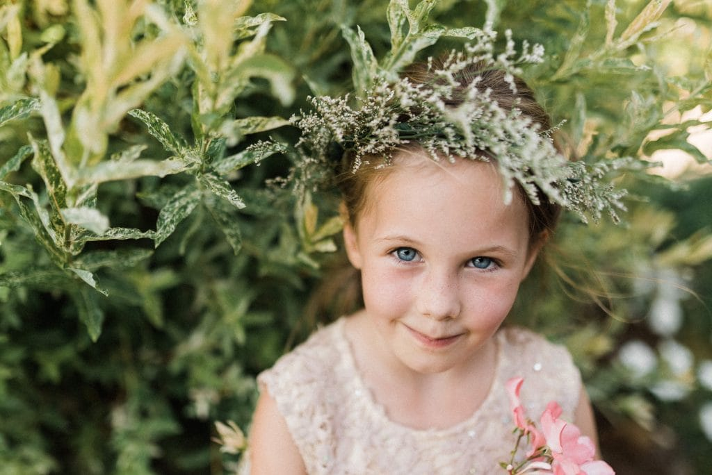 Flower child at outdoor elopement with kids.