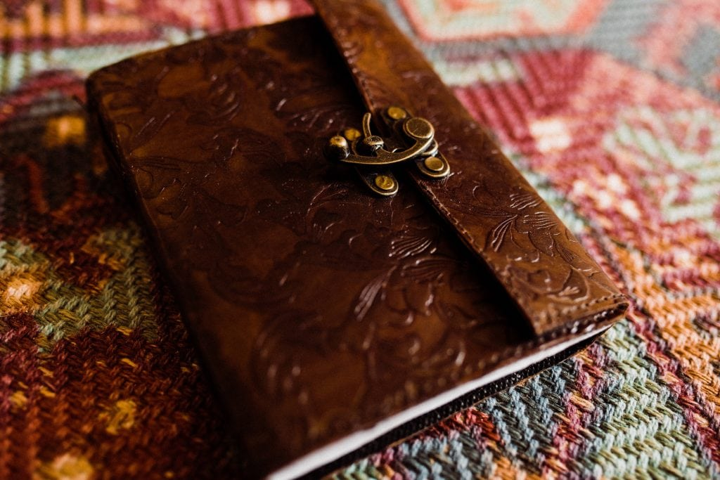 A leather journal is perfect for holding  your handwritten personal wedding vows.