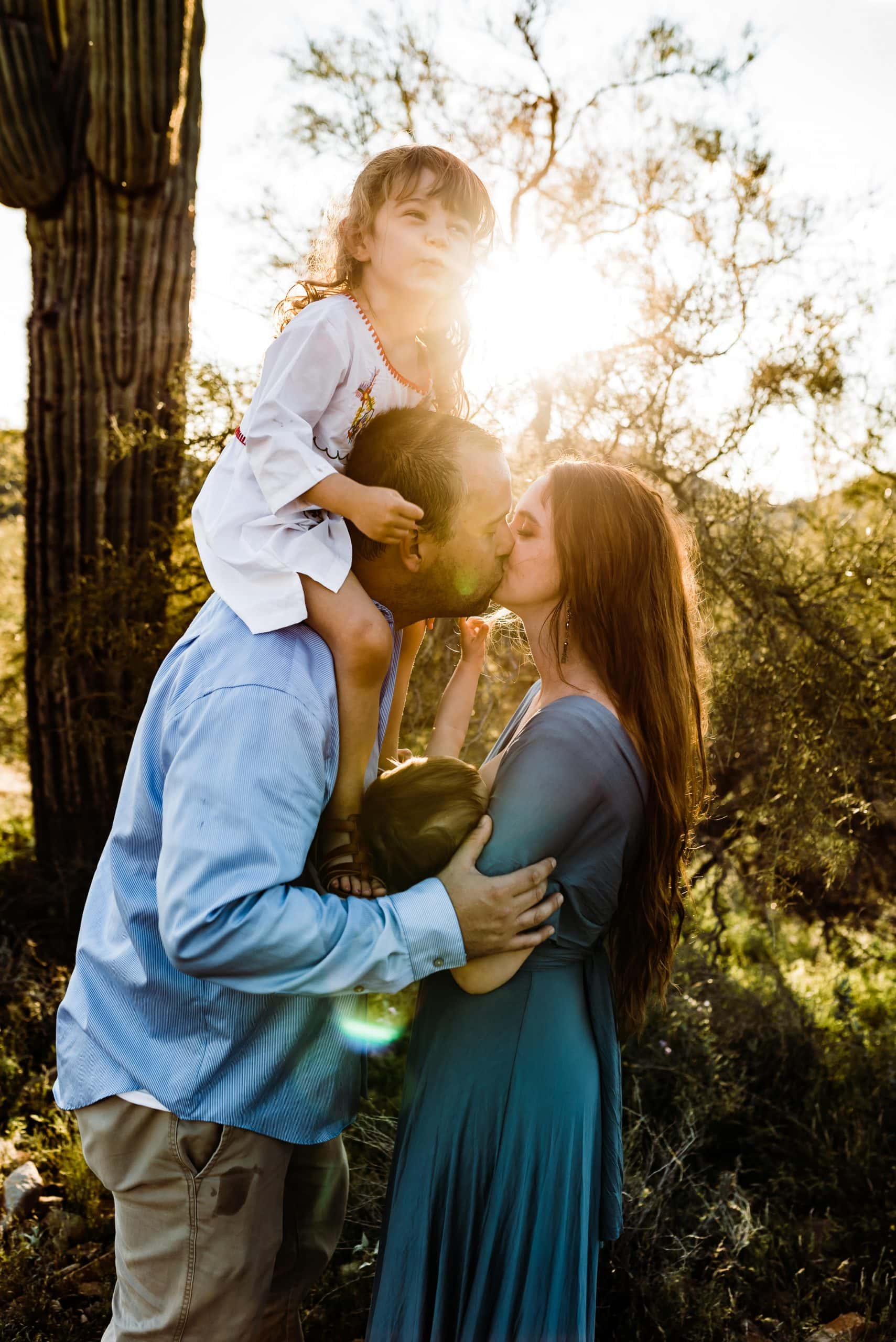 Adventurous family session for family of four at sunset in the desert photographed by Seattle family photographer.