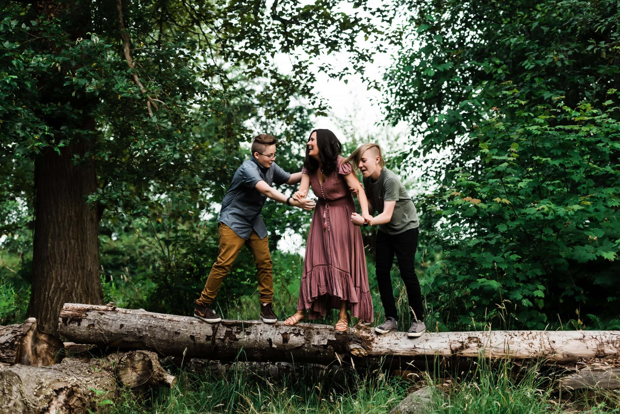 Adventurous family session with mom and two teen boys at Juanita Beach Park outside of Seattle, Washington.